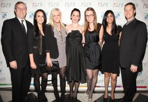 Macy's executives Peter Sachse (left) and Marc Mastronardi flank and (left to right) Norton scholars Brittany Riopelle, Jill Moore, Stephanie Olinski, Lauren Schmidt and Neha Chadna. (Photo courtesy Patrick McMullan)