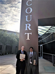 UA professor James Diamond and law student Pete Sabori are seen in front of the Pascua Yaqui Tribe courthouse, where students worked under Diamond's direction.