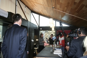 (Click to enlarge) Rep. Gabrielle Giffords met with reporters inside the UA's Solar Decathlon house.