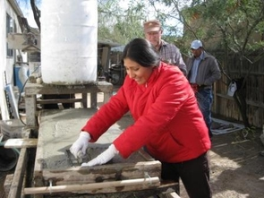 Western Hemisphere Bolivian student learning to build with papercrete, which is a mix of paper and concrete.(Credit: The Western Hemisphere Institute)