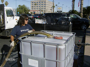 Grecycle Driver Rachel Flores pumps donated waste cooking oil into her truck to haul it off to the biodiesel production facility. (Photo: Mike Kazz)