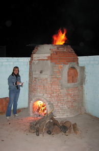 Hasaki uses an experimental replica of an ancient Greek kiln, housed at Tucson's St. Augustine High School, to test hypotheses of kiln design and operation. (Photo courtesy of Eleni Hasaki)