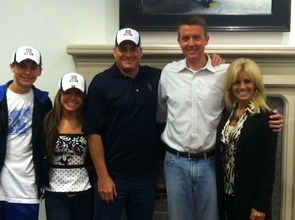 Rich Rodriguez (center) and his family join UA Athletics Director Greg Byrne (second from right) after agreeing to become the next Arizona football coach. (Credit: Greg Byrne)