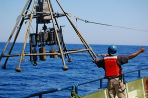 The multi-corer device being lowered into the ocean takes eight one-foot cores from the seafloor. Scientists analyze such cores for clues to the climate of the past several thousand years. (Photo: Peter deMenocal)