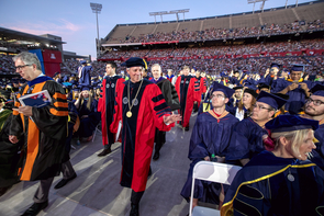 President Robert C. Robbins enters for his first UA Commencement at Arizona Stadium. (Photo: John de Dios/UANews)