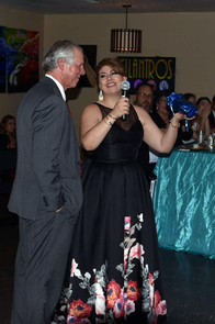 UA President Robert C. Robbins attended this year's Education Unidos Gala, where UA South student services coordinator Melissa Silva presented him with a gift thanking him for his support. (Photo: Ike Dent)