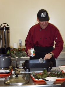"""""""Chef Ed,"""" from the St. Vincent de Paul charity dining room, prepares fresh kale, harvested from the urban garden, in a live cooking demonstration."""