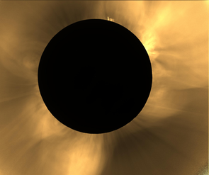 "Adriana Mitchell explains what we see in this image of the 2016 total solar eclipse in Indonesia: ""We applied filters so you can better see the coronal features. Polar plumes — the long thin streamers emerging from the sun's north and south poles — can be seen in the top left and bottom right corners. At the very top is a prominence — plasma that is caught in the magnetic field lines looping through the sun's surface. During totality, we could see it with the naked eye, it was bright red."""