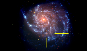 That same galaxy in a NASA Swift image, with bars indicating the location of supernova SN 2011fe. The Swift  image is a false-color image with UV emission blue and optical emission red. (Image: NASA/Swift)