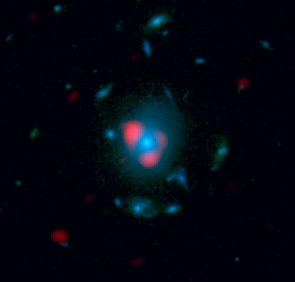Cosmic donut: This image combines data from ALMA and the Hubble Space Telescope. Shown in red is the distant, background galaxy, being distorted by the gravitational lens effect produced by the galaxy in the foreground, shown in blue as measured by Hubble. The background galaxy appears warped into a so-called Einstein ring: a circle of light around the foreground galaxy. (Image: Dan Marrone)