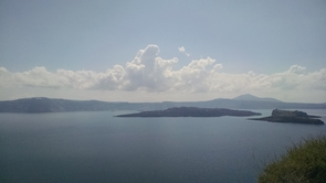 A view across the Santorini caldera from the island of Therasia. The entire calderas is approximately 6 miles in diameter and the islands visible in the center are where the currently active vents are located. (Photo: Gregory Hodgins)