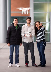 Rodrigo Savage (center), an electrical and computer engineering doctoral student, is developing a drone app store with three M.B.A. students, including Javier Castelo (left) and Michell Bauer. (Photo: Sarah Mauet)