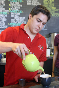 Shane Barela, owner of Scented Leaf Tea House and Lounge, pours a cup of tea at his new location, 943 E. University Blvd.