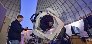 Adam Block adjusting the Schulmann Telescope at the Mt. Lemmon SkyCenter, with which he found the supernova. (Photo: Dave Harvey)