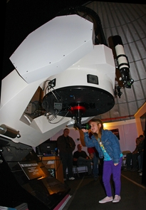 A young visitor peers through the Schulman Telescope during a SkyNights public observing event. (Photo: Adam Block)