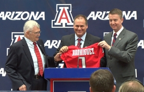 UA President Eugene G. Sander (left) and Athletics Director Greg Byrne (right) welcome Rich Rodriguez (center) to the UA during a news conference.