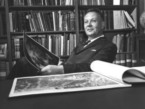 Gerard P. Kuiper with photographs from the Lunar Atlas (Photo: LPL/Space Imagery Center)