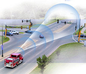 "An emergency vehicle ""talks"" to a smart traffic system. (Illustration courtesy of the U.S. Department of Transportation)"