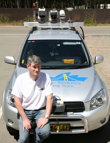 Jonathan Sprinkle with the DARPA Urban Challenge car he worked on at the University of California, Berkeley, before coming to the UA.