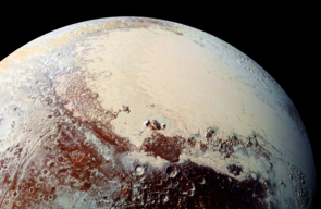 "Sputnik Planitia (the left lobe of Pluto's ""heart"") is believed to be the outer solar system equivalent of a lunar ""mascon"" (mass concentration). Like mascons on the Moon, Sputnik Planitia is believed to be an impact basin, filled in with lavas (on Pluto, cryogenic ices take the place of lavas). (Image: NASA/JHUAPL/SWRI)"