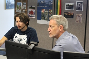 Ash Black (right) helps Tech.Global developer Alan Salguero with some coding. Salguero is working at Tech.Global this summer while visiting from the Instituto Tecnológico de Sonora in Mexico.