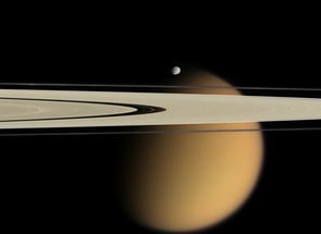 This image taken by the Cassini orbiter on Oct. 15, 2007, shows Saturn's A and F rings, the small moon Epimetheus and smog-enshrouded Titan, the planet's largest moon. The image is colorized to approximate the scene as it might appear to human eyes. (Credit: NASA/JPL/Space Science Institute; Click to enlarge)