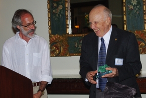 (Click to enlarge) Spencer Titley (right) receives an award for his 50-plus years of teaching and research at the University of Arizona from Joaquin Ruiz, dean of the UA College of Science. (Credit: Lori Stiles)