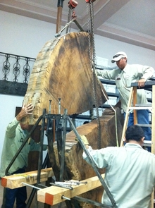 A crew works to dismantle the sequoia piece in preparation for its move across campus.