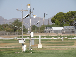 The Arizona Meteorological Network, or AZMET, is a near-real-time agricultural weather information system with 28 stations located throughout Arizona, including this one at the Karsten Turfgrass Research Facility in Tucson. Scientists can combine AZMET data with measurements from weighing lysimeters - big buckets of soil on scales - to predict water use in turfgrass. (Photo by Susan McGinley)