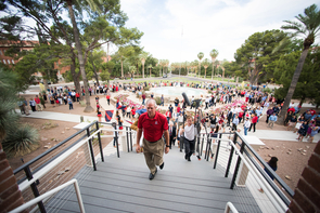 UA President Robert C. Robbins leads well-wishers into Old Main for a meet-and-greet opportunity on his first day at work. (Photo: Jacob Chinn)
