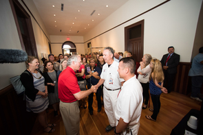 Dr. Robert C. Robbins greets faculty and staff inside Old Main. (Photo: Jacob Chinn)