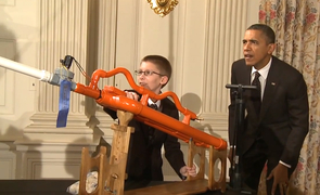 President Barack Obama and 16-year-old Joey Hudy take aim for a demonstration of a high-powered marshmallow gun during the first White House Maker Faire.