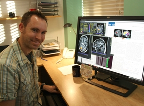 Assistant professor Stephen Wilson studies how the brain processes language by combining brain imaging with performance-based language tests. (Photo: D. Stolte/UANews)