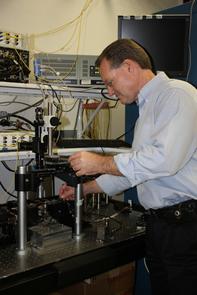 John Wissinger sets up a photonic circuit measurement. (Photo by Beatriz Verdugo/UANews)
