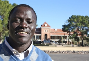 """In making the """"smart"""" decision to send him away, Wol Akujang said his parents decided his brother could """"run if he had to"""" and his younger sister could be carried. But he would not be able to protect himself if Pap, his isolated village, were attacked. He was sent away by foot and, years later, relocated to the U.S. Now, he has graduated from the UA and is preparing for a trip to return to South Sudan."""