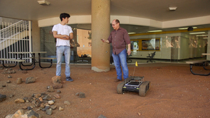 Wolfgang Fink and his team, including student Alex Brooks (left), are working on building a robotic field geologist. (Photo: Bob Demers/UANews)