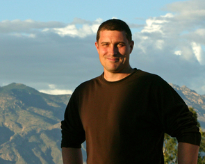 Michael Worobey, assistant professor of ecology and evolutionary biology at the UA. The Santa Catalina Mountains are in the background.