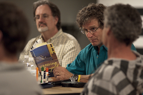 "Erec Toso holds Richard Shelton's book during a 2011 program, ""Inside/Outside Prison Writing Workshop."" (Photo courtesy of ASU Art Museum)"