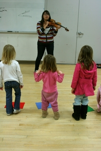 Terra Stockellburg, a UA music education student, teaches some of the younger children in the String Project. The program generally accepts teenagers and children as young as 3.
