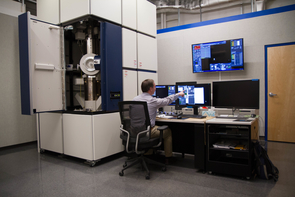 Tom Zega sits at the Hitachi transmission electron microscope, or TEM, in the Kuiper Space Sciences Building. The TEM was funded jointly by the National Science Foundation and NASA. (Photo: Mari Cleven/UA Office of Research, Discovery and Innovation)