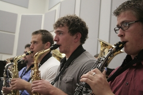 UA sophomore Chad Travis (second from right) chose to attend the UA for two reasons – the Eller College of Management and the School of Music. Travis maintains a minor in music.