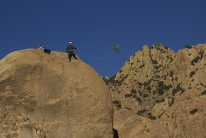 Matthew Packard (left) tosses a rope to Luke Stauffer during a rock-climbing trip at Cochise Stronghold. (Photo: Tobey Schmidt)