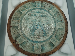 A Mixteca-style shield decorated with turquoise mosaic from the collection of the Smithsonian Institution-National Museum of the American Indian (Photo: Frances F. Berdan)