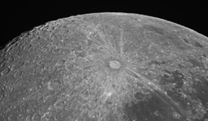 The craters along the uppermost limb, or the very upper edge, are candidate targets for the LCROSS impact in this image of the moon's south pole. The bright, rayed crater that dominates the center of this picture is Tycho. Adam Block of UA's Mount Lemmon SkyCenter took this image.