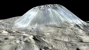 Ceres' lonely mountain, Ahuna Mons, is seen in this simulated perspective view. The elevation has been exaggerated by a factor of two. The view was made using enhanced-color images from NASA's Dawn mission. (Image: NASA)