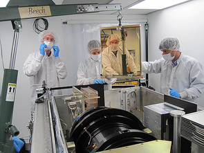 A photo of four SDSS-III scientists working on the APOGEE spectrograph. (Photo: Dan Long/Apache Point Observatory