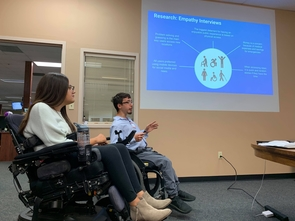 "Erin Thomson and Phillip Bramwell explain the importance of their empathy interviews to Arizona Daily Star editors and executives for their mobile app, ""Tucson Access Guide."" (Photo: Michael McKisson)"