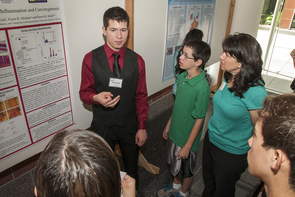 A major component of the KEYS program is that students must present their work during a research symposium. High school student Harrison Jacobs presented during the summer, detailing his research on the correlation between inflammatory bowel disease and colon cancer. (Photo credit: Bill Lax)