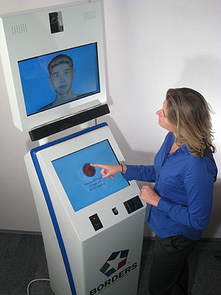 The BORDERS AVATAR kiosk is an example of the technology UA Eller College of Management researchers have developed using non-invasive artificial intelligence and sensor technologies for lie detection.