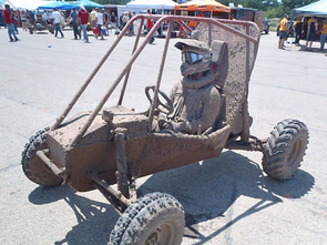 UA Baja Racing driver Robbie McCarthy sits encrusted in mud after the mud bogging event at the 2012 Baja SAE Collegiate Design Series in Burlington, Wis.